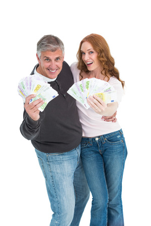 Casual couple showing their cash on white background photo