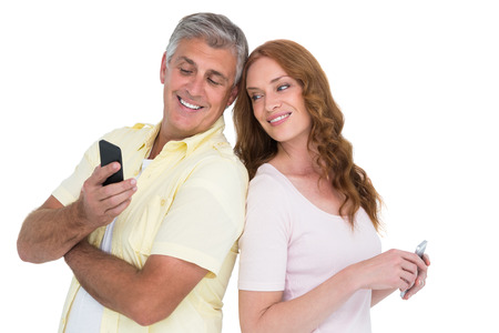 Casual couples on their phones on white background photo