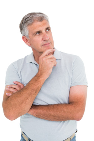 thinking person: Casual man thinking with hand on chin on white background