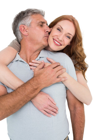 Casual couple hugging and smiling on white background photo