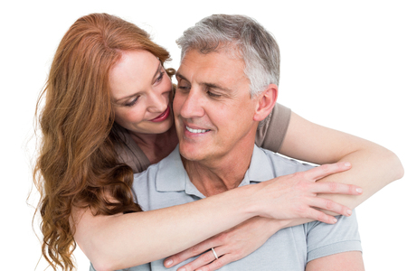 married together: Casual couple hugging and smiling on white background