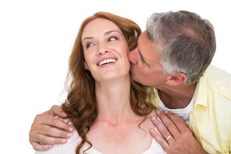 Man giving his partner a kiss on white background photo