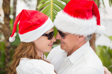 holidaying: Holidaying couple celebrating christmas in a green park Stock Photo