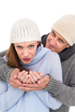 warm clothing: Casual couple in warm clothing on white background