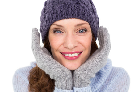 Pretty redhead in warm clothing on white background photo