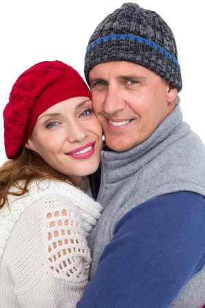 warm clothing: Happy couple in warm clothing hugging on white background Stock Photo