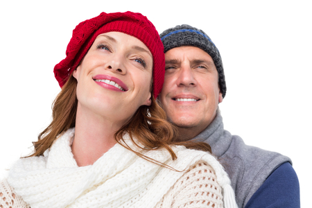 warm clothing: Happy couple in warm clothing on white background Stock Photo