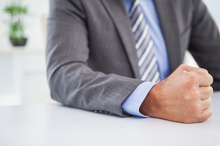 banging: Angry businessman banging his fist in his office Stock Photo