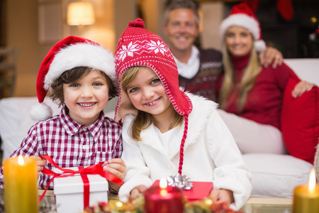 child couple: Cute family celebrating christmas together at home in the living room