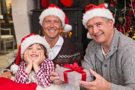 three generation: Three generation family celebrating christmas Stock Photo
