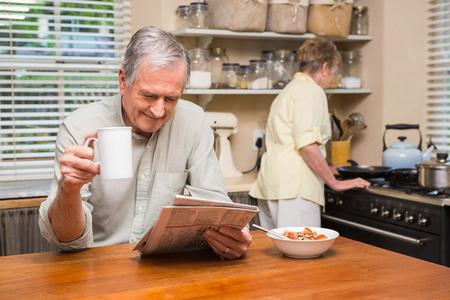 Senior couple spending the morning together at home in the kitchen Stock Photo
