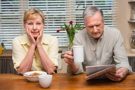 Senior couple spending the morning together at home in the kitchen photo