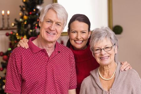 Portrait of a happy family at christmas at home in the living room photo