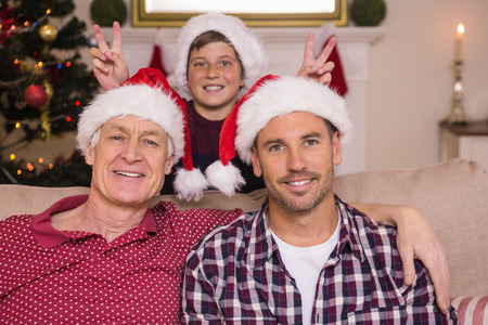 joking: Son joking to his father and grandfather at home in the living room Stock Photo