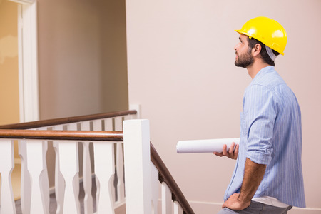 envisioning: Casual architect walking up the stairs in a new house