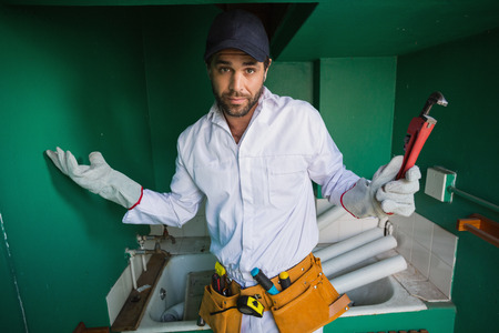 protective work wear: Construction worker shrugging at camera  in a new house Stock Photo