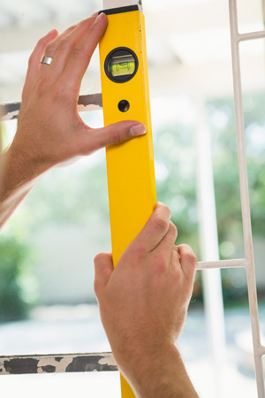 spirit level: Spirit level on the window in a new house Stock Photo