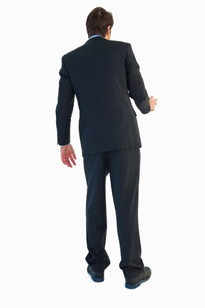 men shirt: Rear view of businessman opening a door on white bakcground