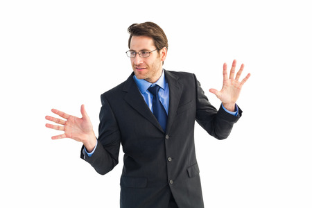 Businessman standing with fingers spread out on white background photo