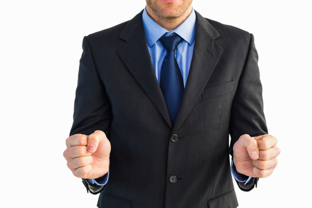 clenching: Businessman standing clenching his fists on white background Stock Photo