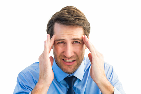 Young businessman with severe headache on white background photo
