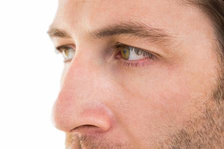 unsmiling: Close up of unsmiling man on white background
