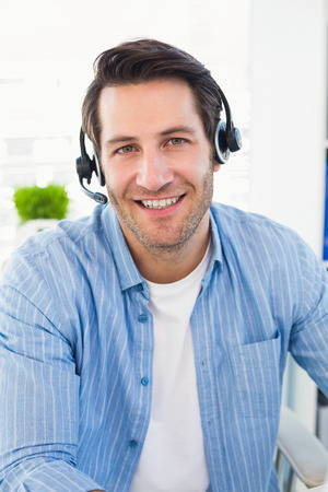 editors: Smiling photo editors wearing a headphone in office Stock Photo