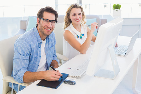 graphics tablet: Graphic designer using a graphics tablet in his office Stock Photo