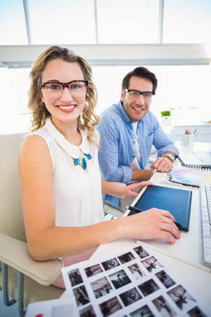 graphics tablet: Photo editors working together on graphics tablet in office Stock Photo