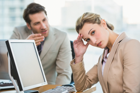 apologetic: Businessman arguing with a colleague at work