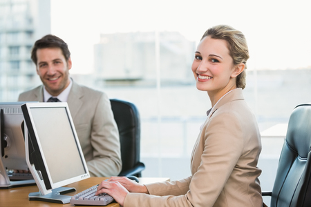 young business people: Two young business people using computer in office