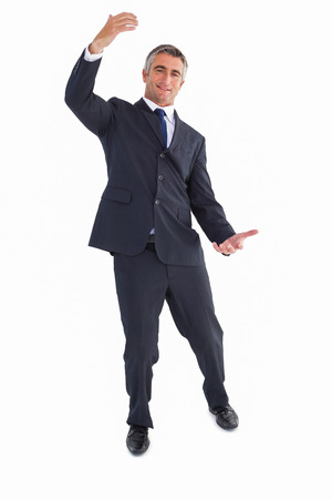 well dressed: Happy businessman well dressed with arms out on white background