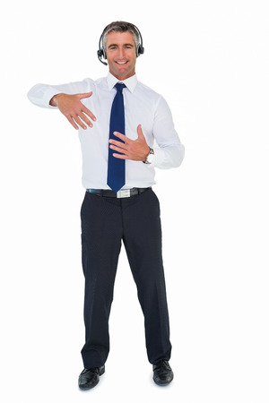 Businessman wearing headphone and doing gesture on white background photo