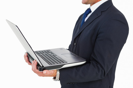 cut wrist: Mid section of a businessman holding laptop on white background