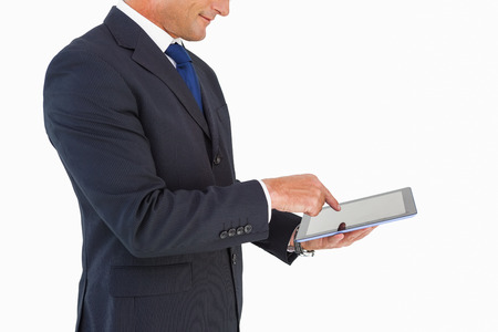 cut wrist: Businessman in suit using digital tablet on white background