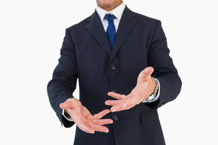 cut wrist: Mid section of a businessman with arms out on white background