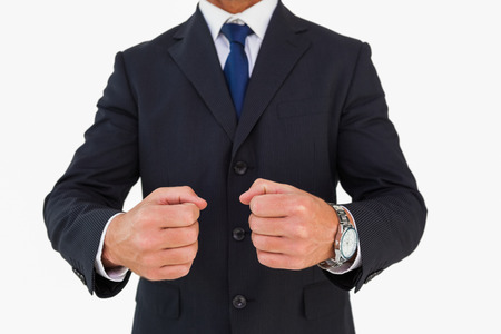 cut wrist: Businessman in suit clenching fists on white background