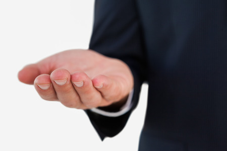 cut wrist: Close up of a businessman with hand out on white background