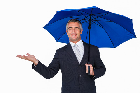 hand out: Happy businessman under umbrella with hand out on white background