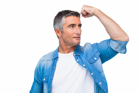 grey hair: Man with grey hair tensing arm muscle on white background