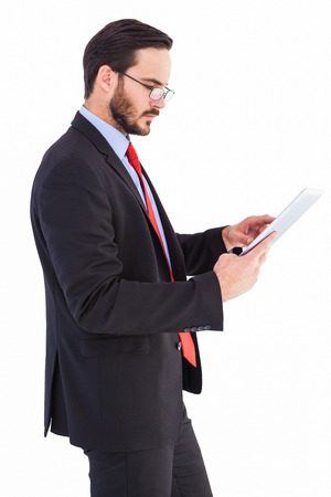 Businessman scrolling on his digital tablet on white background photo