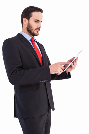 scrolling: Businessman scrolling on his digital tablet on white background