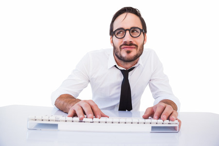 Business worker with reading glasses on computer on white background photo