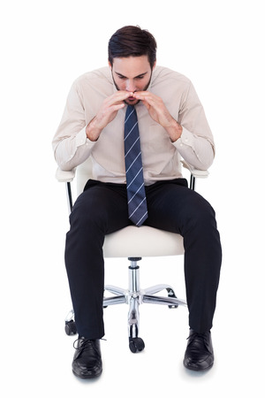 swivel: Businessman sitting on swivel chair shouting on white background