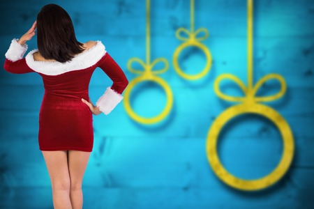 sexy santa: Rear view of sexy santa girl against blurred christmas background