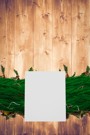 Fir branch christmas decoration garland  against bleached wooden planks background photo