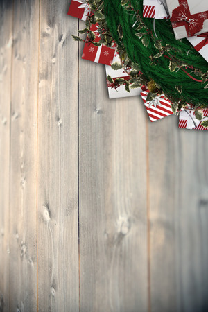 Festive christmas wreath with decorations against bleached wooden planks background photo
