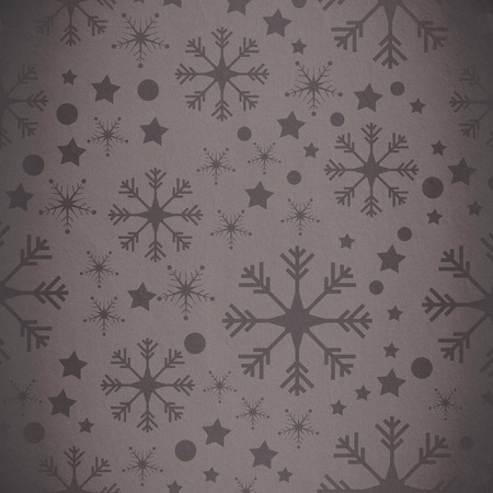 grey pattern: Snowflake pattern against grey vignette Stock Photo
