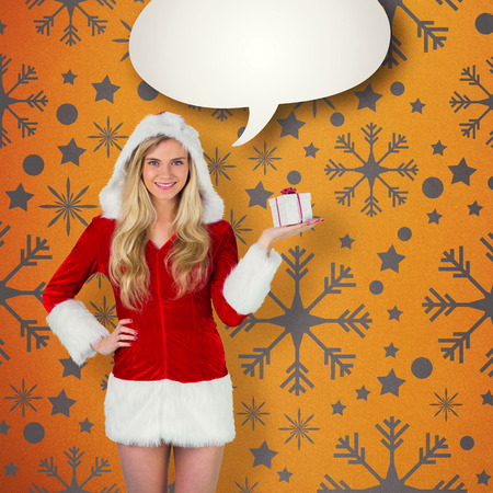 Pretty girl in santa outfit holding gift against yellow vignette photo