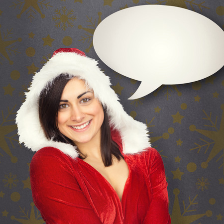 Pretty girl smiling in santa outfit against grey vignette photo